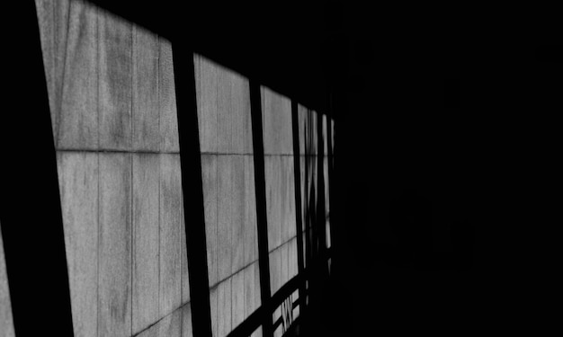Shadow from glass window on marble wall in the room