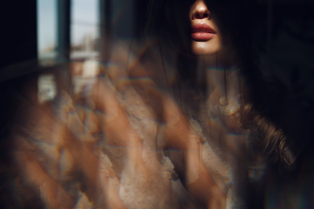 Shadow hides beautiful woman with sensetive lips