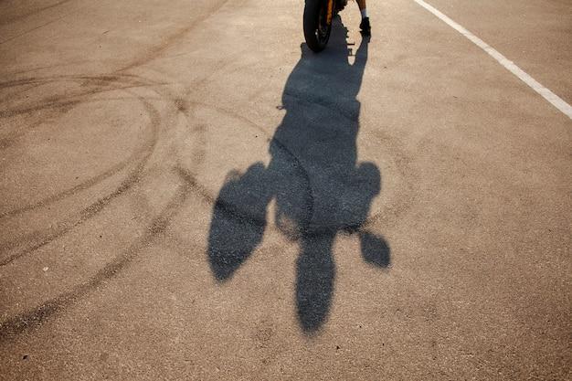 Shadow of male holding helmet