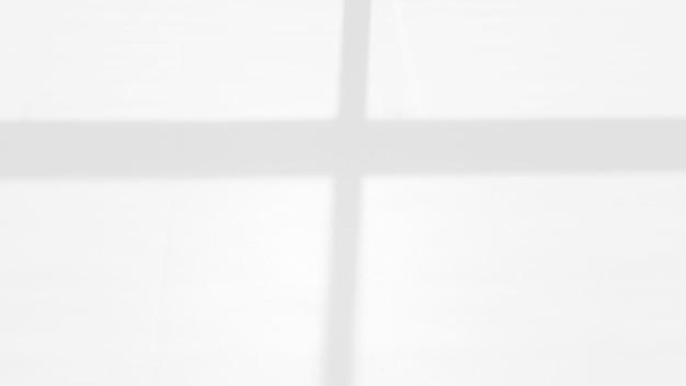 写真のモックアップ製品の壁のアートデザインのプレゼンテーションのための白い壁のオーバーレイ効果の窓の影
