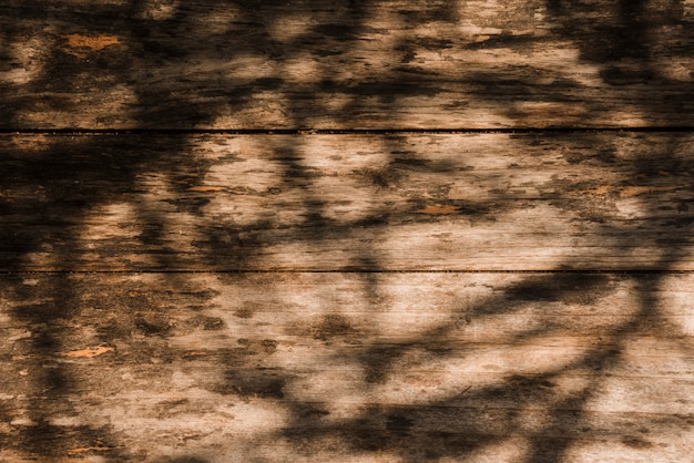 Shadow over the old wooden backdrop