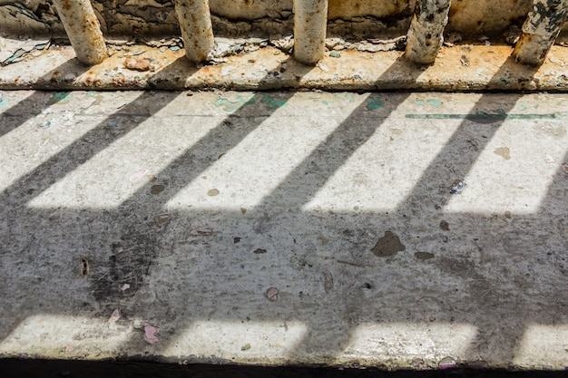 Shadow shining through the bars of the old prison
