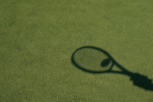 Shadow of a tennis racket with a ball