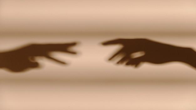白い壁に手の影