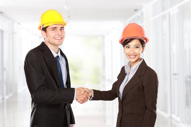 Shaking hands at construction site