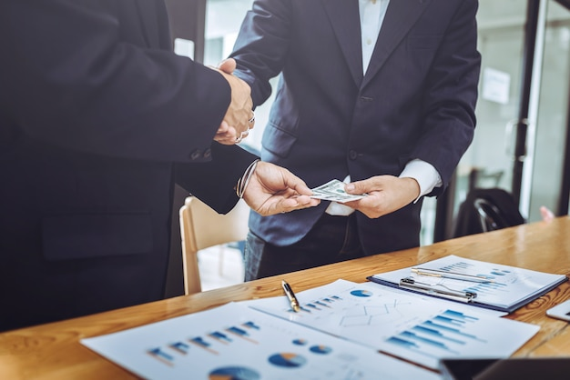Shaking hands working together two business man.