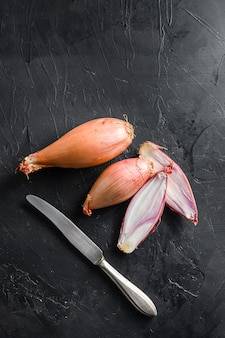 Shallot, eschalot or scallion raw onions sliced