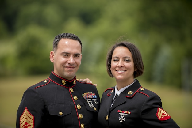 Shallow focus shot of a military couple smiling
