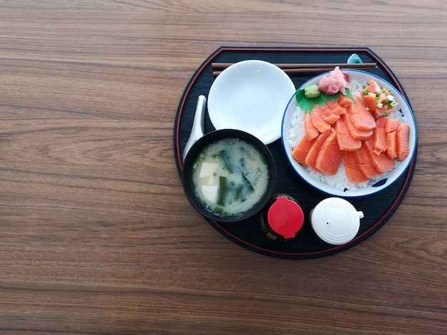 Shalmon sashimi in dish on wooden table