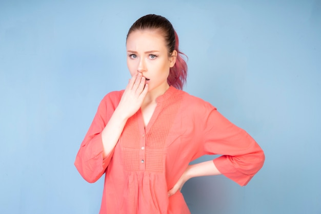 Shaming girl with coral colored blouse