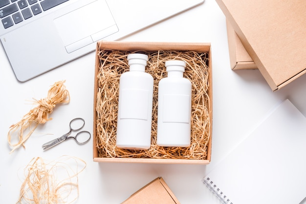 Shampoo bottles on cardboard box