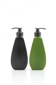 Shampoo or hair conditioner bottle on white