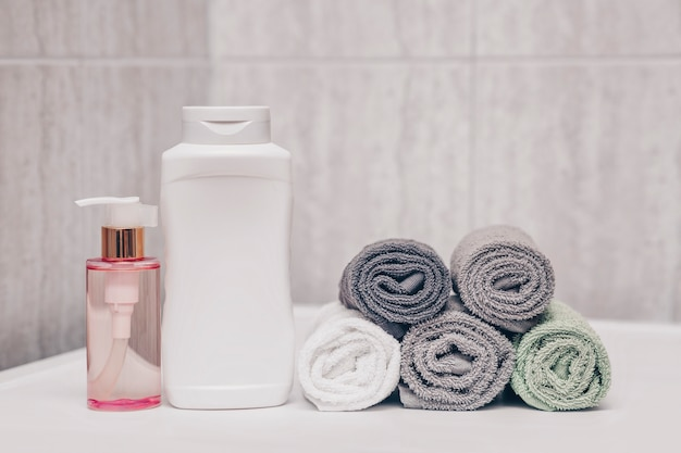 Shampoo large tube rose oil to soften hair and towels in the bathroom