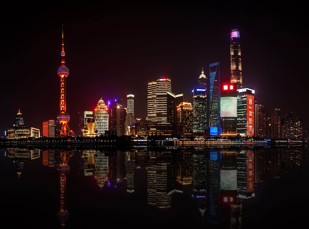 Shanghai, china - may 17, 2018: the oriental pearl radio and television tower and shanghai buildings. panoramic view from the embankment of the vaitan to the pudong district