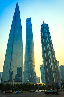 Shanghai, china: october 9, 2015. shanghai world financial centre, shanghai tower and jin mao tower at lujiazui district in shanghai. shanghai tower is newest and the tallest. (632m).