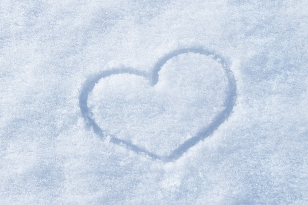 The shape of heart painted on the white snow