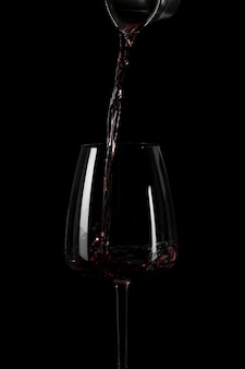 Shape of pouring wine in the dark