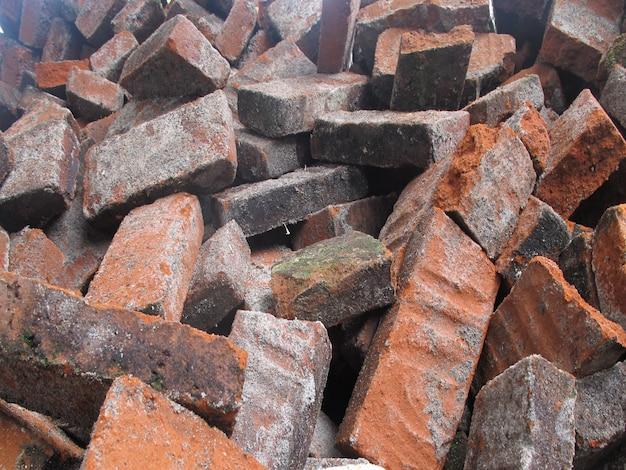 Shards of red bricks on the ground