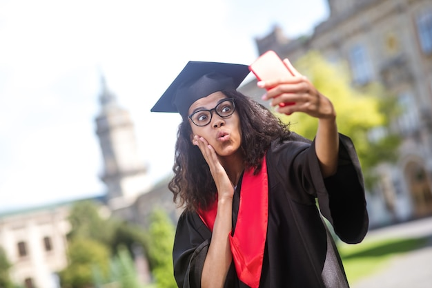 Sharing good news. young graduate feeling happy and excited on a video call