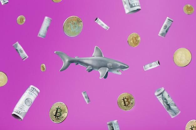 ピンクの背景にドルとビットコインに囲まれた中央のサメ