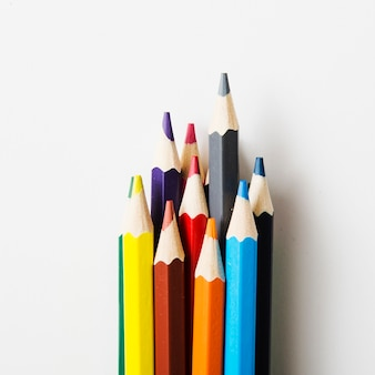 Sharp colored pencils against white background