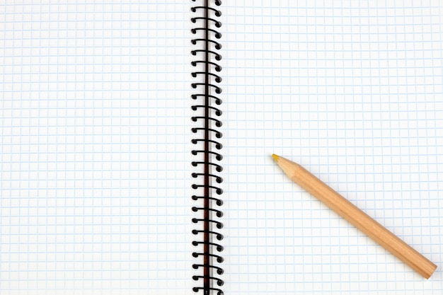 Sharp pencil on a spiral notebook in blank
