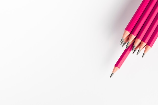 Sharp pink pencils bunch against white background