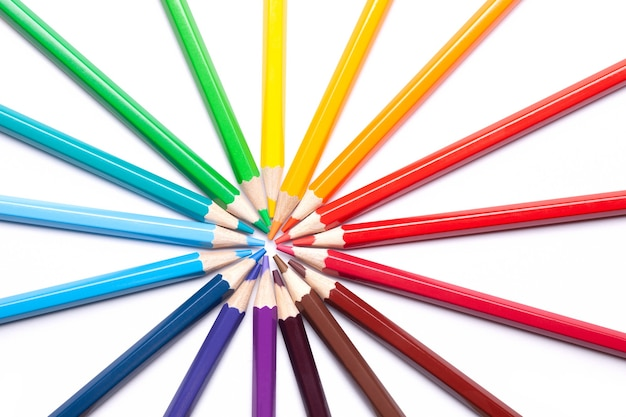 Sharpened colored pencils lie in a circle with their noses in the center, school supplies, lgbt symbol, horizontal.