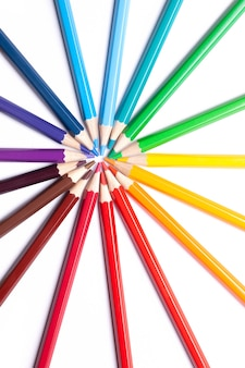Sharpened colored pencils lie in a circle with their noses in the center, school supplies, lgbt symbol.
