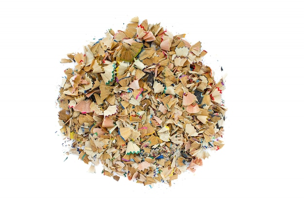 Sharpened pencils and wood shavings. background with colored pencils