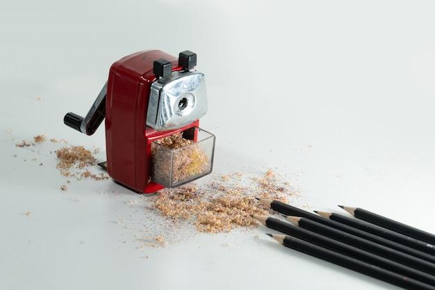 Sharpener and black wooden pencil shavings
