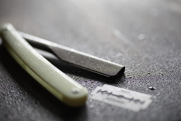 Shaving accessories on a wooden texture background and disposable blades