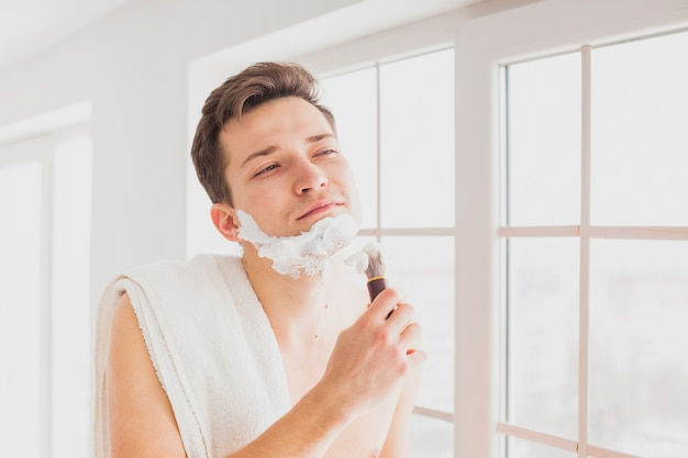Shaving concept with attractive man