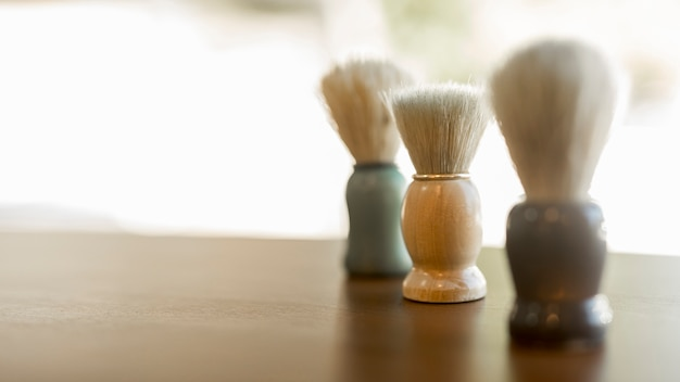 Shaving cream brush set on desk