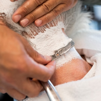 Shaving male neck with straight razor