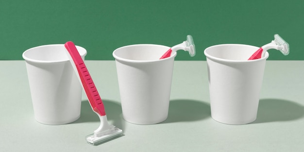 Shaving razors in cups