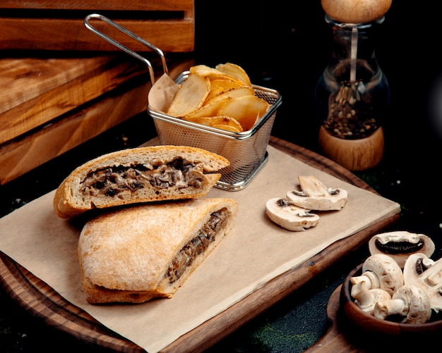 Shawarma in bread with chips and mushrooms