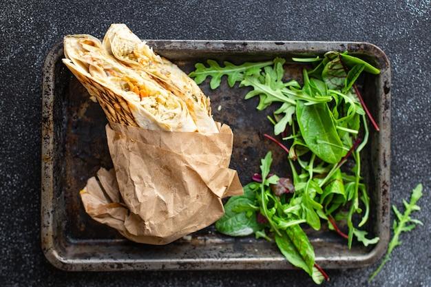 Shawarma fresh roll sandwich vegetables sauce meat chicken pork lamb beef taco tortilla flatbread wrap