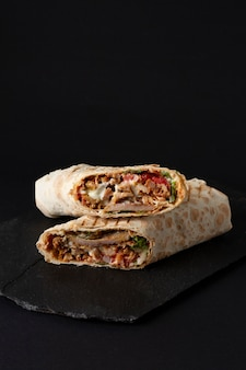 Shawarma, roll in lavash , grilled meat, with vegetables, sandwich