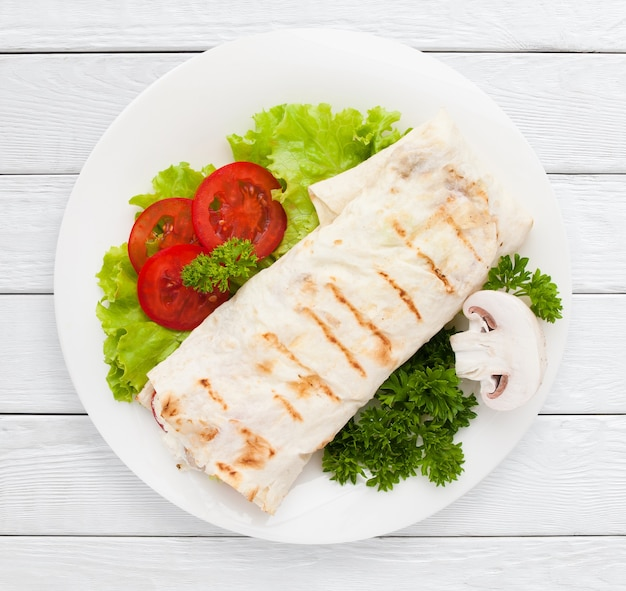 Shawarma. sandwich wrap of pita bread on plate