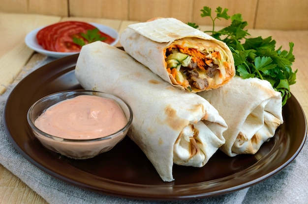 Shawarma stuffed with: grilled meat, sauce, vegetables