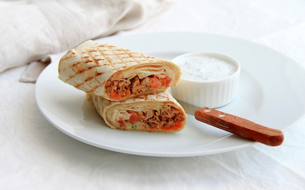 Shawarma with meat in a white plate