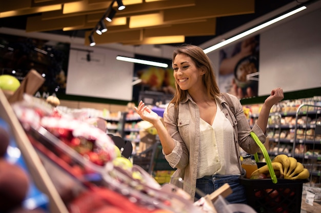 She enjoys buying fruit in supermarket