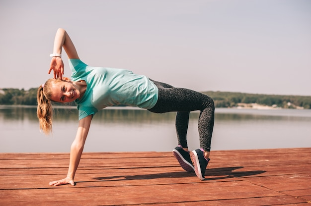 She performs exercises on pier