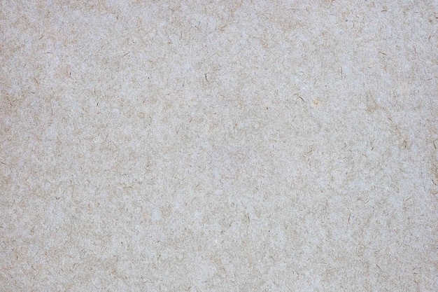 Sheet of brown paper or cardboard texture for table.
