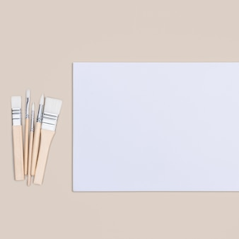 The sheet is pure white and the paint brushes are on a beige background with a place to copy