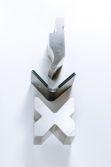 Sheet metal bending tool and equipment isolated on a white background. special bending machine forming mold punch and die. press brake tools, bend tools, press brake punch and die.