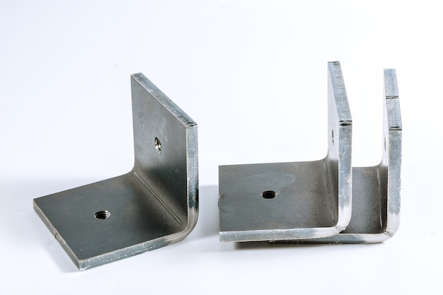 Sheet metal product after processing on a bending machine. sheet metal bending tool and equipment isolated on a white background. special bending machine forming mold punch and die.