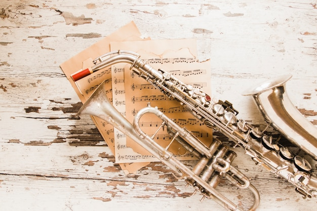 Sheet music under saxophone and trumpet