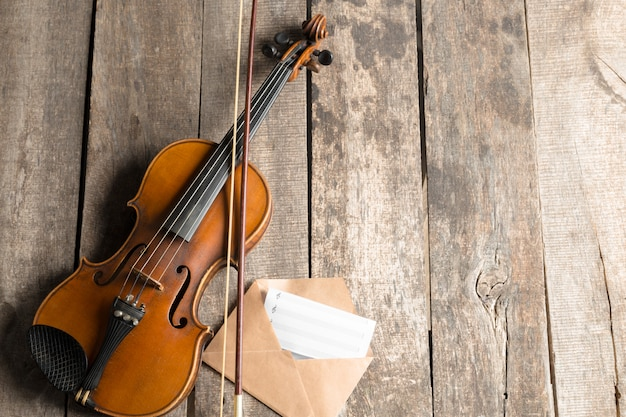 Sheet music and violin on wooden table